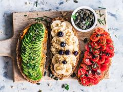 Fruit + Veggie Toast (ella.o) Tags: fruit vegetables avocado banana tomatoes toast bread breakfast snack fruittoast veggietoast healthy cuttingboard pumpkinseeds veggies food meal sweet