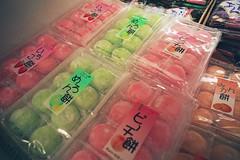 Mochi Night (Jetcraftsofa) Tags: nikonf3 micronikkor5528 fuji reala100 35mm slr filmphotography availablelight mochi peach melon strawberry grocery store market konbini