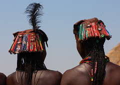Muhacaona tribe women with kapapo headdress made of soda cans, Cunene Province, Oncocua, Angola (Eric Lafforgue) Tags: adult adults africa africantribe angola angolan colourimage cuneneprovince day decoration developingcountries ethnicgroup feather hairstyle horizontal humanbeing indigenousculture lifestyles metal mucawana muhacaona muhakaona necklace nonurbanscene oncocua ornament oshiwawbo outdoors photography plait recycling ruralscene traditionalhairstyle traditionalornament tribal tribe twopeople wastematerials ang0k6g0008