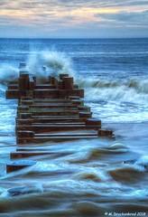 Windswept Waves at Rehoboth Beach Delaware (PhotosToArtByMike) Tags: rehobothbeachdelaware woodenjetty delaware stormwateroutfall jettypilings de beach marylandavenue stormwaterdischargepipe pipe wave waves windsweptwaves sussexcounty rehoboth atlanticcoast atlanticocean sunrise