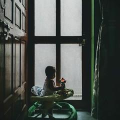 Waiting (Parveen Singh) Tags: kid baby child girl cute play playtime wait waiting walker curtain dark shadow sunlight