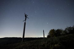 Nuss and Stars 2 (Notquiteahuman1) Tags: statues metal nuss germany strümpfelbach dark night longexposure starfigures wideangle dancing posts newmoon milkyway trees autumn europe hill landscape outdoor illumination light stars star luz noite estrela astro sky astrology