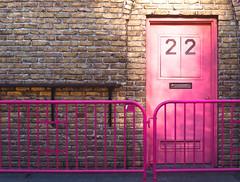 Door 22 (Orbmiser) Tags: olympus40150mmf4056r 43rds em1 mirrorless omd olympus ore oregon portland sidewalk barricade door pink
