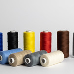 Sewing thread of different colors isolated on white thumbnail