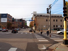 P1010244 (Minneapolis Public Works Streets) Tags: downtown north loop pedestrian sidewalk commercial crossing crosswalk dog signal intersection washington ave n 5th bike lane buffered