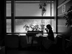Please take it easy... (明遊快) Tags: monochrome bw woman window table sunlight shadow lines silhouette japanese gr2 空港駅