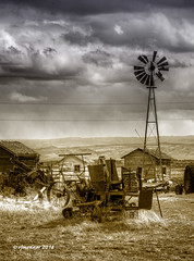 Ramshackle_187125 (rjmonner) Tags: agriculture agricultural antique abandoned aged acreage agronomy agronomic antiquity acres blades country clouds dilapidated decay decayed deserted dry exposed elevation earth farm farmland grass grasses homestead hills isolated inert junk nikon land light latent machinery neglected natural old outdoors oxidized outbuildings quaint antiques rural relic rustic rusted rust sky textured tattered usa vintage vanishing windmill windmillwednesday yesteryear bygonedays farmyard