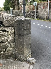 19th Century Mile Marker - Village of Quin, County Clare, Ireland - October 2018 (firehouse.ie) Tags: 1825 milestone eire oldireland distances roadway junction roadside quin countyclare village ireland milestones milemarker limestone rock stone antiquated old ancient