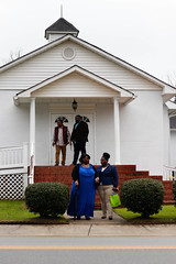 A'Nasia Monford stands next to her mother, Amy Monford, as they wait outside the church.