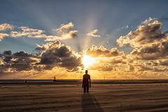 Staring at the sun...... (gmorriswk) Tags: merseyside england unitedkingdom gb sunset sunburst landscape seascape beach sand antony gormley iron men statues ironmen