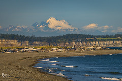 The Mountain and the Shore (RobertCross1 (off and on)) Tags: a7rii admiraltyinlet alpha cascaderange cascades e55210mmf4563oss emount ilce7rm2 jefferson mountbaker mtbakersnoqualmienationalforest olympicpeninsula pacificnorthwest pointwilson porttownsend quimper sony wa washington whidbeyisland beach bluesky cliffs clouds fullframe glacier island landscape mirrorless shore snow telephoto