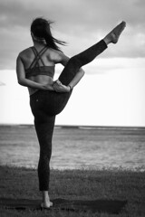 Bird of Paradise Yoga Pose (Corey Rothwell) Tags: girl woman yoga pose bw beach waves oahu honolulu waikiki clouds yogi