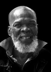 Portrait (D80_520220) (Itzick) Tags: manhattansep2018 bw blackbackground bwportrait beard man face bold streetphotography portrait d800 itzick