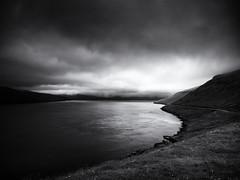Fjord III (Feldore) Tags: faroeislands faroe moody landscape fjord feldore mchugh em1 olympus 1240mm water road clouds fog islands mono