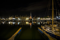 """in the dark night, with the yacht gone, quai St Etienne still casts its colourful reflections, Honfleur, Normandy, Normandie, Calvados, France (grumpybaldprof) Tags: """"vieuxbassin"""" """"oldharbour"""" honfleur calvados normandie normandy france quai """"quaistetienne"""" water boats sails ships harbour historic old ancient monument picturesque restaurants bars town port colour lights reflection architecture buildings mooring sailing stone collombage halftimbered yachts reflections """"waterreflections """"églisesaintétienne"""" yacht voillier waterfront ethereal striking artistic interpretation impressionist stylistic style contrast shadow bright dark black white illuminated colours colourful """"longexposure"""" """"dark night nocturne nighttime """"lowlight"""" canon 70d """"canon70d"""" sigma 1020 1020mm f456 """"sigma1020mmf456dchsm"""" """"wideangle"""" ultrawide"""