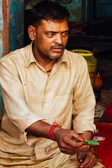 Paan Wallah Selling Paan, Uttar Pradesh (AdamCohn) Tags: 014kmtobaldevinuttarpradeshindia adamcohn baldeo baldev india uttarpradesh geo:lat=27408078 geo:lon=77822360 geotagged holi paan paanwallah portrait street streetphotography wwwadamcohncom