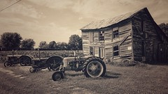 this year's case lineup... (BillsExplorations) Tags: tractor thursday rust vintage old oldtractor oldhouse dilapidated forsale lineup decay ruraldecay nora illinois mainstreet rustic weathered htt sepia snapseed caseinternational casetractor