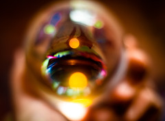 Focused On The Unfocused (DocktorGonzoPhotography) Tags: crystal crystalball lensball outoffocus bokeh colorful trippy psychedelic psychedlia psychedlical hand photography indoors light exposure goodexposure 50mm 50mmlens canon canonlens 50mmf18 f18 shadows highlights rainbow reflections reflect acid lsd shrooms glow haze hazy spots circles composition ruleofthirds subject unfocused blurry blur blurred