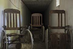 The Isolation Hospital (Sean M Richardson) Tags: abandoned isolation hospital vintage wood wheelchair creepy decay detail canon photography urbex exploration depth dark 50mm