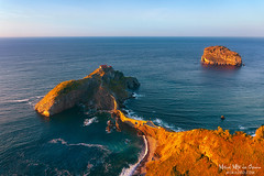 San Juan de Gaztelugatxe (Mimadeo) Tags: gaztelugatxe sanjuandegaztelugatxe basquecountry paisvasco euskalherria coast euskadi sunny ocean spain sea juan landscape basque san biscay vizcaya country bermeo water bizkaia nature tourism de ermitage destiny touristic view tourist bakio landmark travel beautiful sunlight sunset blue island coastline scenic sky seascape highangleview
