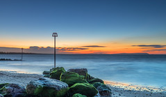 Solent Dawn (nicklucas2) Tags: seascape beach avonbeach dorset mudeford groyne sea seaside solent wave cloud isleofwight dawn