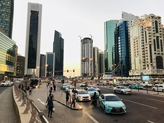 Busy evening by the DCC shopping center (Pavel's Snapshots) Tags: busy traffic downtown street dcc dohacitycenter westbay doha qatar middleeast evening sunset sunlight sky bright taxi urban town business mobile iphone mall phone shoppingcenter filter vivid travel office