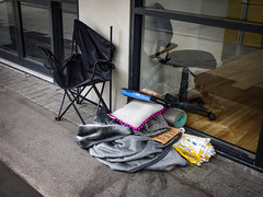 The Chair Inside and the Chair Outside (Steve Taylor (Photography)) Tags: pillow blanket mat broken collapsing pizzabox homeless sign tramp vagrant chair door window newzealand nz southisland canterbury christchurch cbd city distorted