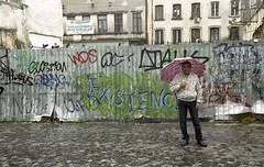 Man in the rain (Manuel Goncalves) Tags: rain umbrella bucharest road 35mmcolourfilm kodakportra400 nikonn90s romania epsonv500scanner
