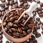 Coffee beans in a wooden bowl background thumbnail