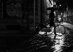 d r e s s   c o d e (Gaia Rampon) Tags: milan night rain winter blur bycicle umbrella street streetphotography streetphotographer blackandwhite black white noiretblanc colorblind colorless bw bnw ombres lumiere brera workingwoman