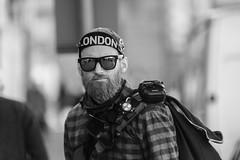 Londoner (Frank Fullard) Tags: frankfullard fullard candid street portrait monochrome london cyclist headband ballinasloe galway irish ireland black white blanc noir english england tourist visitor