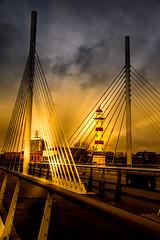 Sunset by the bridge (Maria Eklind) Tags: universitetsbron lighthouse sunset color malmö sweden posthusplatsen himmel bro city outdoor sky bridge solnedgång clouds skånelän sverige se