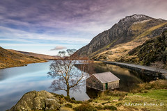 Lake and Moon Snowdonia (Adrian Evans Photography) Tags: snowdonia nikon winter idwal water romanroad lake snow ogwenvalley wales lonetree road tree uk northwales sky valley nantffrancon landscape snowdonianationalpark halfmoon landmark moon clouds d850 highway adrianevans ogwenlake building lakeogwen tryfanmountain outdoor boathouse architecture mountain