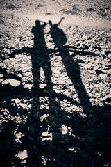 You and me (iamunclefester) Tags: vacation holiday croatia krk otokkrk blackandwhite monochrome toned castshadow hardshadow bright hot sun sunlight shadows shadow karst mattock hiking long you me youandme stone rock rocks mountains mountain wasteland island mountainwasteland barren dry
