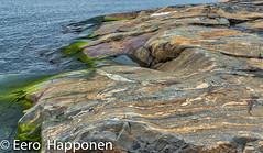 Colorful beach rock (Eero Happonen) Tags: afsdxnikkor135451870mmged porkkala porkkalanniemi maaliskuu maaliskuu2008 meri merimaisema rantakallio porkkalapeninsula thegulfoffinland sea nikond70