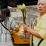 Marking offering cloth, flower for the chedi, Wat Doi Suthep.  Chiang Mai, Thailand thumbnail