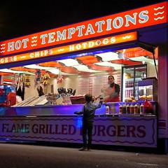 Temptation (heresthething...) Tags: night shoot dark food fast fairground fun fair g7 lumix micro43 nightlife burger hotdog takeaway grill flame lights urban street mirrorless temptation