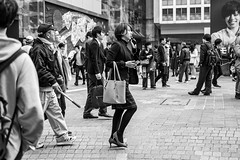 Two Fisted Talker (burnt dirt) Tags: asian japan tokyo shibuya station streetphotography documentary candid portrait fujifilm xt1 bw blackandwhite laugh smile cute sexy latina young girl woman japanese korean thai dress skirt shorts jeans jacket leather pants boots heels stilettos bra stockings tights yogapants leggings couple lovers friends longhair shorthair ponytail cellphone glasses sunglasses blonde brunette redhead tattoo model train bus busstation metro city town downtown sidewalk pretty beautiful selfie fashion pregnant sweater people person costume cosplay boobs