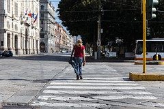 Crossing (fiore_lla4ever) Tags: crossing girl hat red cagliari street photography city life photo lightroom canon eos 6d flower