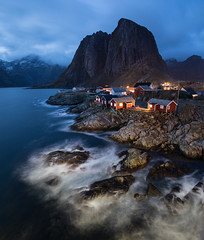 Blue Hour at Hamnøy, Lofoten, Norway (Peter Starling) Tags: 2018 lofoten norway peterstarling arctic island islands hamnoy norge bridge autumn long exposure sea eliasen rorbuer eliassen fisher fisherman hut cabin log red dusk dark night waves blur motion lights mountain cloud ocean norwegian light huts rocks shore shoreline landscape rheine reine moskenes nordland fjord reinefjorden water overcast snow