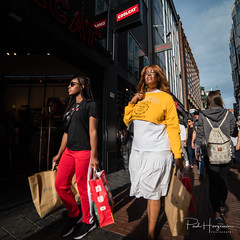 Shopping diva's @ Amsterdam (PaulHoo) Tags: amsterdam city urban citylife people candid streetphotography color vibrant sun summer shadow shopping 2018 nikon d750 ultrawideangle wideangle samyang 14mm