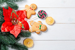Funny gingerbread men with tree branches and a red Christmas flower on white boards (wuestenigel) Tags: lemon twigs newyear candy boards sweet gingerbread cookies christmas christmastree background icing white