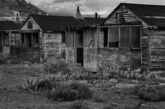 Varanda (arbyreed) Tags: arbyreed old abandoned forgotten wooden barracks armyaircorpswendover wendoverbaseutah b17 b29 atomicbomb enolagayb29bomber wwii monochrome bw blackandwhite dark