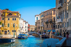 Venice has beautiful water canals and colorful buildings everywhere.