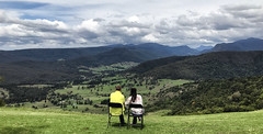 Admiring God's Canvas (Manoj D'Souza) Tags: numinbah valley beechmont mountain couple clouds grazing grass grasslands grassy lookout chair romantic scenic rim gold coast hinterland south east queensland canungra