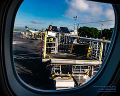 Steering A PDX Portable Ramp to the ERJ-175 (AvgeekJoe) Tags: iflyalaska alaskaair alaskaairlines d5300 dslr kpdx nikon nikond5300 oregon pdx portland portlandinternationalairport skywestairlines usa airport window