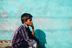 Thinking Boy on Blue Wall, Mathura India (AdamCohn) Tags: adam cohn uttar pradesh india mathura vrindavan boy holi shadow sweat thinking wall wwwadamcohncom adamcohn uttarpradesh govardhan