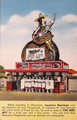 """The Beer Hut"" on Highway 41 in Fond du Lac, Wisconsin.  Linen Postcard 31811 published by E.C. Kropp Co. (ca. 1940s) (lhboudreau) Tags: postcards postcard miller sign beer milwaukee wisconsin building beverage alcohol beerkeg breweriana vintagepostcard ephemera paperephemera eckroppco 1940 1940s kropp advertising advertisement advertisingpostcard drivein stand beerstand roadside america roadsideattraction beerhut thebeerhut hut fonddulac linenpostcard postcard31811 31811 keg barrel millerhighlife drinkthebest brewski sombrero hat banner highway41 originalwisconsindriveinstand people outdoor reststop lunch originalbeerhut theoriginalbeerhut carhop carhops"