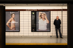 Fighters and Trailblazers (cookedphotos) Tags: 2018inpictures toronto ontario canada ca canon 5dmarkiv streetphotography ttc ossington subway station platform knix advertisement women fighter trailblazer typography man waiting commute 365project p3652018