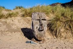 Photo of Maoi Statue on Barmouth Beach, Gwynedd, Wales
